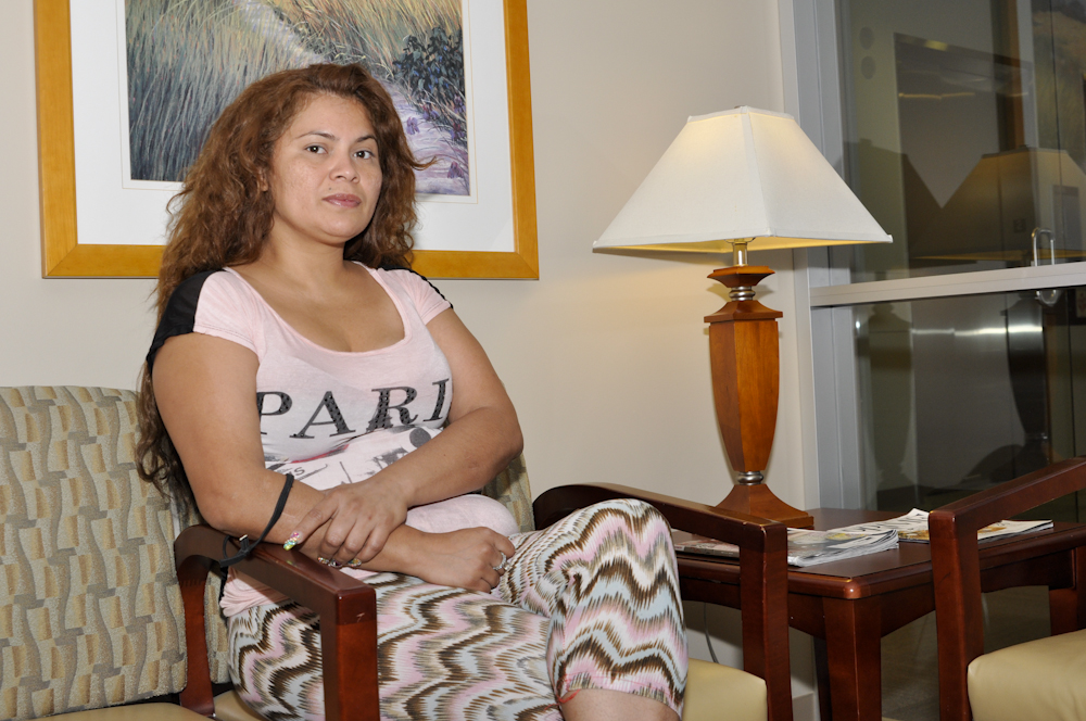 Patient Gabriela Arellano sits in the waiting room before her surgery.